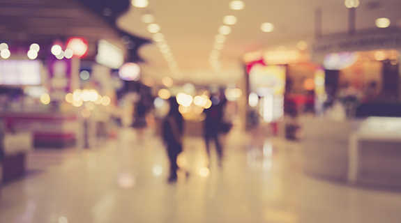 Blurred image of people in shopping mall with bokeh, vintage color